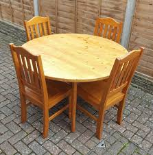 solid pine dining table with 4 pine chairs round furniture in