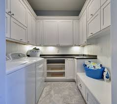 u shaped laundry room features shaker cabinets paired with black