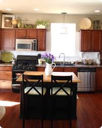 Above Kitchen Cabinet Decorations Best 25 Above Cabinet Decor Ideas On Pinterest Top Shining
