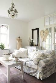 shabby chic style living room with sofa and mannequin and mirror