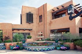 adobe house santa fe adobe house with fountain stock photo getty images