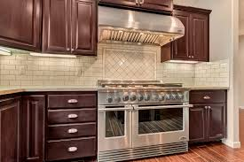 subway tile backsplash with a matching arabesque accent behind