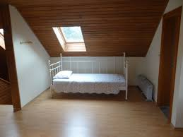 modern attic bedroom ideas with couple bed orangearts minimalist