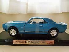 1967 camaro z 28 road legends yat ming 1967 white orange chevrolet camaro z 28 1 18