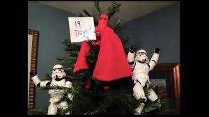 stormtroopers putting christmas tree star wars christmas