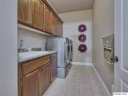 traditional laundry room with specialty door u0026 built in bookshelf