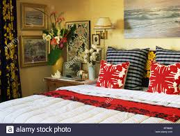 red white patterned cushions and black white striped cushions on