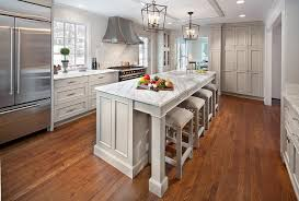 island stools for kitchen white and gray kitchen with floor to ceiling pantry cabinets