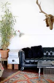 nashville tufted leather sofa living room eclectic with black fur