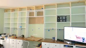 White Bookcases With Doors by Remodelaholic Build A Wall To Wall Built In Desk And Bookcase