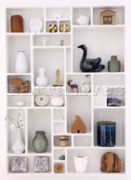 bd129 16 selection of ornaments in wall shelf in buss