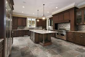 large kitchen with hanging small chandeliers over island with