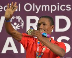 table tennis los angeles genet ducame from haiti shows off his gold medal for table tennis