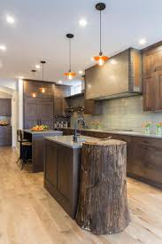 craftsman kitchen with tree stump butcher block two islands