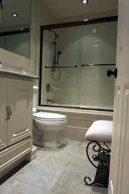 glass door on rectangle bathtub with brown polished metal grab bar fancy oval white acrylic standing tub