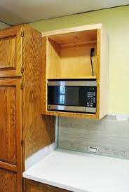 Building A Kitchen Cabinet Two Pieces Of Plywood Screwed To The Outsides Of A Wall Cabinet Is