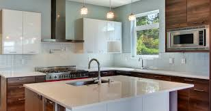 vapor glass subway tile kitchen backsplash and white wood kitchen