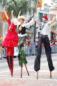 clown stilts stilts clowns entertaining the crowd at sixth annual
