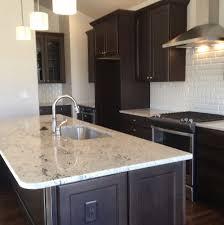 espresso kitchen cabinets with white quartz home design ideas