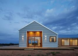 corrugated steel provides durable facade for house by glow design