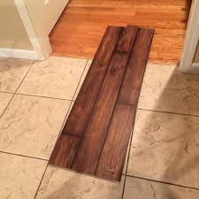 installing laminate flooring around kitchen cabinets installing