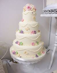 4 tier vintage style wedding cake with flowers and butterflies by
