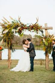wedding arch kent rustic 2 post wooden arch with asymmetrical florals greens