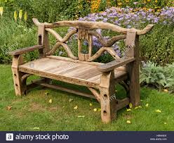 ornate rustic wooden garden bench seat made from recycled wooden