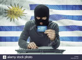 Flag Uruguay Dark Skinned Hacker With Credit Card And Flag On Background
