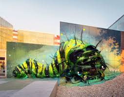 these murals mix street art with the recycling bin creators a raccoon made out of garbage it s almost too perfect