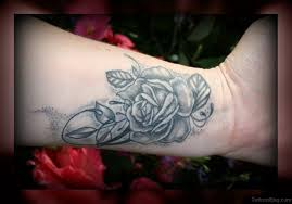 15 delightful black rose tattoos on wrist