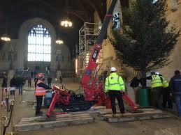 unic spider crane brings christmas cheer to uk parliament unic