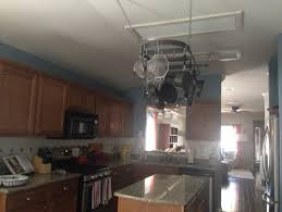 Fluorescent Light Fixtures For Kitchen by How To Update Hideous Fluorescent Lighting In Kitchen