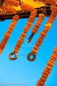 wedding mandap marigold garlands brass bells bamboo sticks