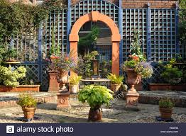 back garden with trellis and mirror stock photo royalty free