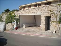 porte sezionali hormann portoni sezionali h禧rmann per un elegante villa in costa smeralda