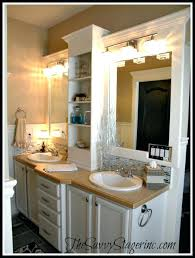 builder grade framed bathroom mirror frame and add a shelf to builder grade