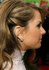 how to wear hair behind the ears run a smoothing serum through hair before blow drying with a large