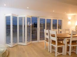 Exterior Folding Patio Doors Folding Patio Door Made From White Wooden Materials And