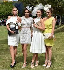 glamorous women don supersized headgear at glorious goodwood