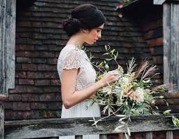 hair and make up artist on love lust or run the copse wedding venue terracotta styled shoot by jenna hewitt