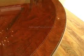 large 84 inch round mahogany dining room table seats 10 reeded edge and feather decorated apron