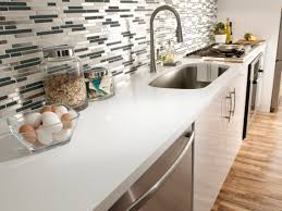 countertops kitchen with white cabinets and black appliances