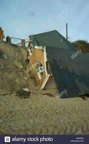 Bungalow Homes by Sea Erosion To Cliffs At Hemsby Norfolk England Cause Bungalow