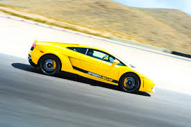 yellow lamborghini race a lamborghini on track in vegas speedvegas