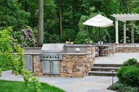 spanish influenced raised stone patio beechwood landscape
