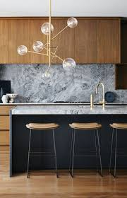 pot filler wall mounted faucet in polished bronze white marble
