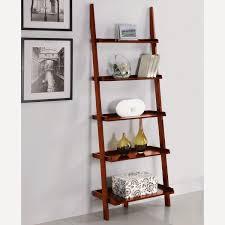 decorating natural brown wood ladder bookshelf on white ceramics