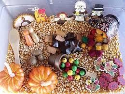 some ideas for a thanksgiving sensory tub popcorn acorns