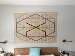 Rugs At Ikea by Creating A Wood Quilt Hanger Turns An Ikea Rug Into A Wall